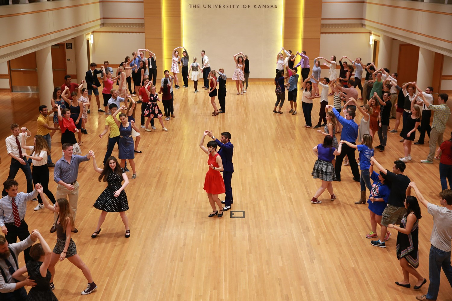 Photo of many students in a ballroom swing dancing